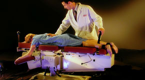 This is a picture of Cox Technic chiropratic spinal manipulation as performed at Johnson Chiropractic.
